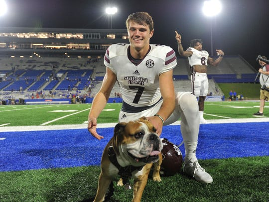 Mississippi State Bulldogs quarterback Nick Fitzgerald (7) poses for a picture with Bully after the game against the Louisiana Tech Bulldogs earlier this season.