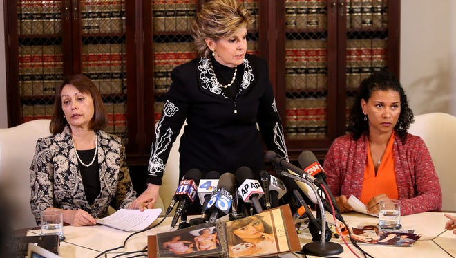 Attorney Gloria Allred (C) at news conference with Linda Brown (L) and Lise-Lotte Lublin (R), two new accusers of Bill Cosby, on Feb.12,in Los Angeles,