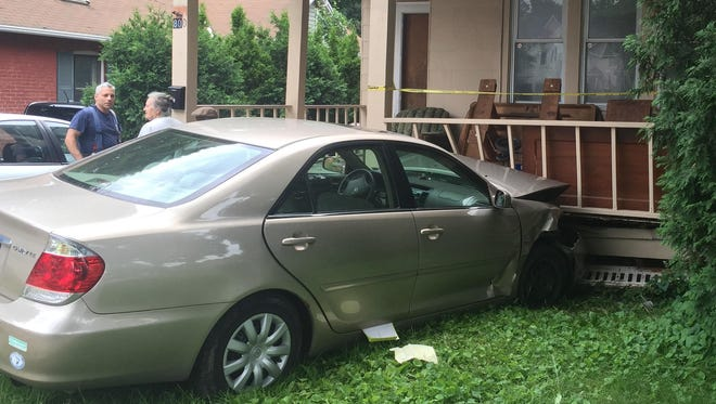 Police say the driver of this Toyota Camry passed out at the wheel and crashed into a home at 800 South Ave. on July 4, 2015.