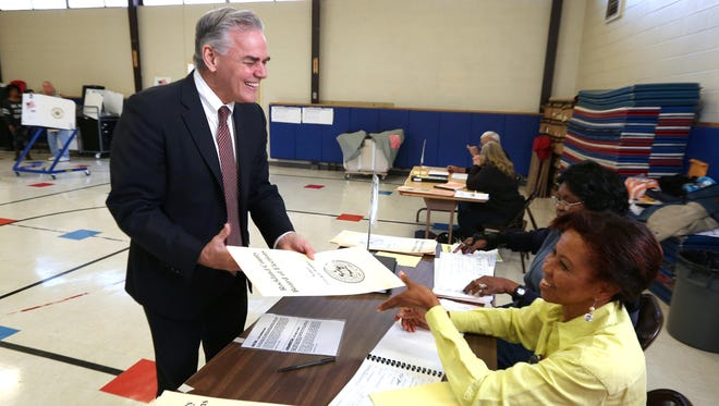 Town of Ramapo Supervisor Christopher St. Lawrence signs in to vote with elections inspector Ketlie Pignard at Grandview Elementary School in Monsey Nov. 3.