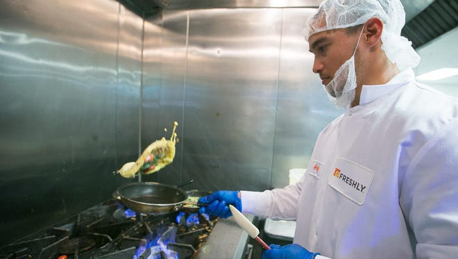 Angel Sanchez prepares omelets at Freshly, a meal-delivery service company in Tempe. Freshly received $7 million in second-quarter funding.