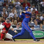 The Mets' Kelly Johnson watches his solo home run in the 11th inning against the Atlanta Braves at Turner Field Saturday night. Johnson's home run gave the Mets a 1-0 victory.