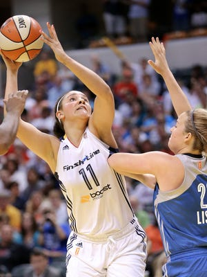 Indiana Fever rookie Natalie Achonwa takes a shot over Minnesota forward Tricia Liston in the second half of their season opener at Bankers Life Fieldhouse on Saturday, June 6, 2015.