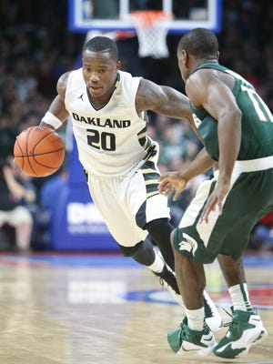 Oakland University Grizzlies  Kay Felder drives against the Michigan State Spartans Tum Tum Nairn during second half action Tuesday, December 22, 2015 at the Palace of Auburn Hills.