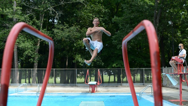Ian Way, 14, leaps off one of the diving boards Aug. 18 at Colburn Pool in Green Bay. Ian Way, 14, Leaps off one of the diving boards Aug. 18 at Colburn Pool in Green Bay.