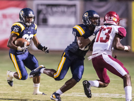 Carencro's Trejun Jones (26) waits for the block as