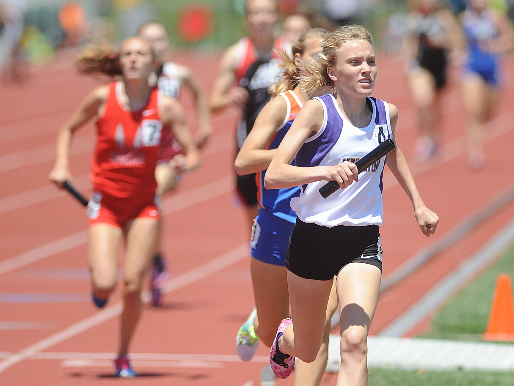 Lex's Dominique Clairmonte, competing in the 4 x 800 meter relay at the 2014 state meet, is the reigning state champion in cross country and the indoor metric mile and two-mile runs.