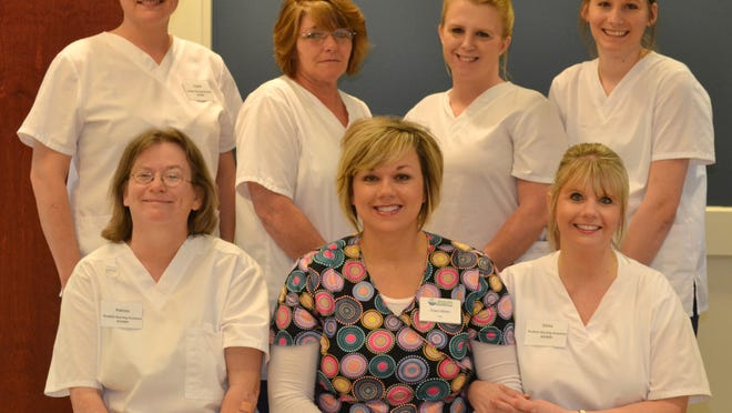Arkansas State University Mountain Home recently honored six graduates of the Certified Nursing Assistant program. Graduates completed 99 hours of course work and passed a skills and knowledge test to graduate. Shown are, first row, from left, Patricia Goodall, instructor Traci Ohler, registered nurse, and Elisha Sharp, second row, Crystal Laster, Sally Gould, Amber Windelkin and Nicole Robinson.