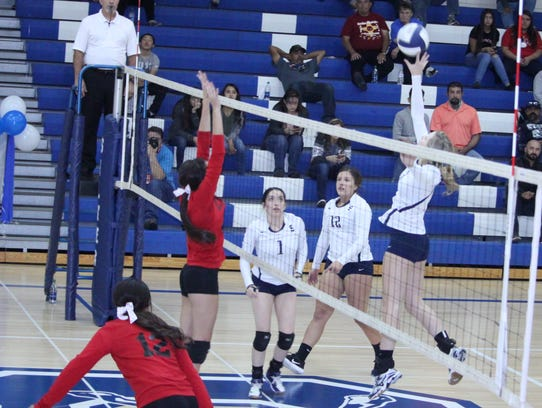 Silver's Shelby Laney gets the touch going during volleyball