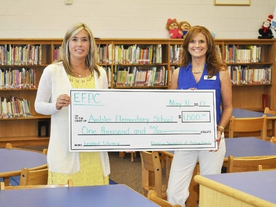 Courtney Vaughan, Reading Coach at Ambler, received her grant award from foundation chairperson Wendy Helmendach.