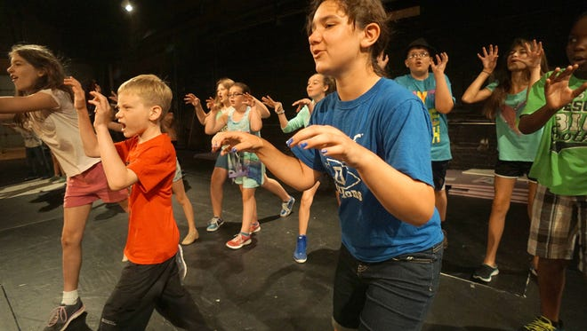 """Children rehearse a scene from """"The Lion King"""" on Thursday morning at the Renaissance Theatre during the Camp Broadway program."""