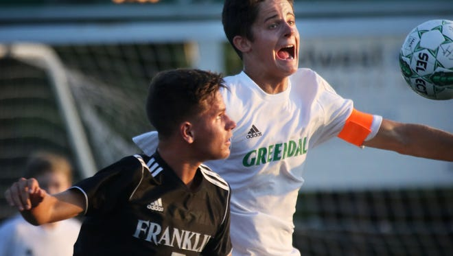 Franklin's Joe Thiry (5) and Greendale's Josh Richlin battle for control of the ball during the teams' nonconference game at Greendale in 2016. Thiry and the Sabers had a memorable season in 2017.