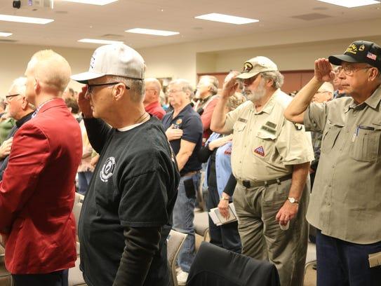 Local Vietnam War veterans salute the colors during