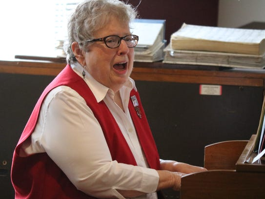 Kay McIntosh, of Port Clinton, performs with the Elders