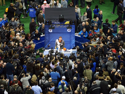 Jan 28, 2014; Newark, NJ, USA; Denver Broncos quarterback Peyton Manning is interviewed during Media Day for Super Bowl XLIII at Prudential Center. Mandatory Credit: Kirby Lee-USA TODAY Sports ORG XMIT: USATSI-171830 ORIG FILE ID:  20140128_pjc_al2_018.JPG