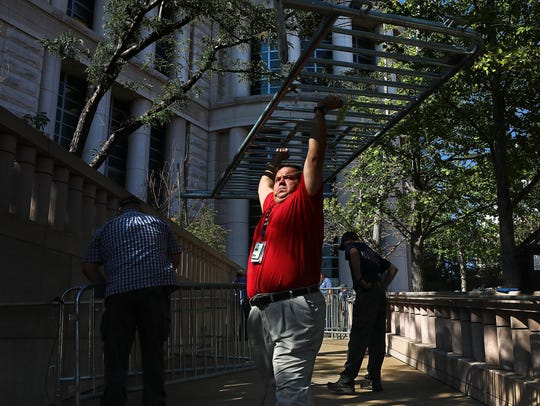 Officials begin erecting barricades outside the Thomas