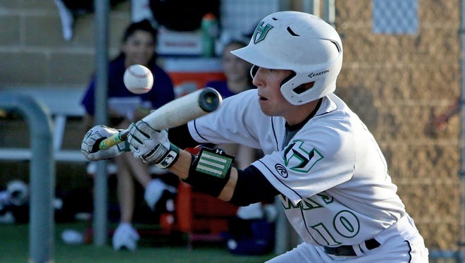 Iowa Park's Braxton Briones pops up a bunt against Godley in Game 1 of the Region I-4A finals Wednesday, May 30, 2018, at Northwest High School in Justin.