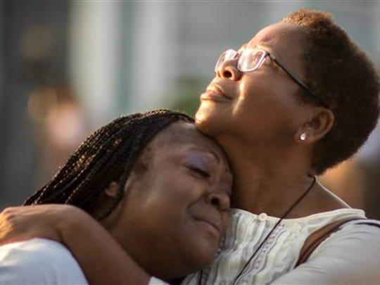 Gillettie Bennett, right, comforts Clarissa Jackson,