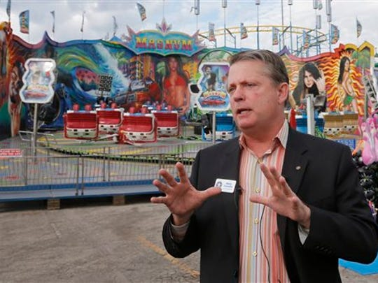 FILE - In this Wednesday, Sept. 10, 2014, file photo, Oklahoma Labor Commissioner Mark Costello speaks during a news conference at the state fairgrounds in Oklahoma City. Authorities say Costello has died after a stabbing at an Oklahoma City restaurant on Sunday, Aug. 23, 2015.