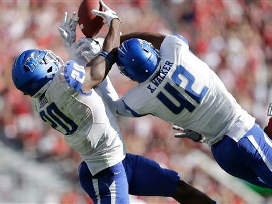 Middle Tennessee safety Kevin Byard (20) intercepts a pass thrown by Alabama quarterback Jake Coker in the first half Saturday in Tuscaloosa.