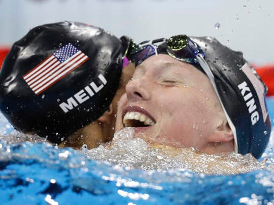 United States' Katie Meili, left, congratulates her