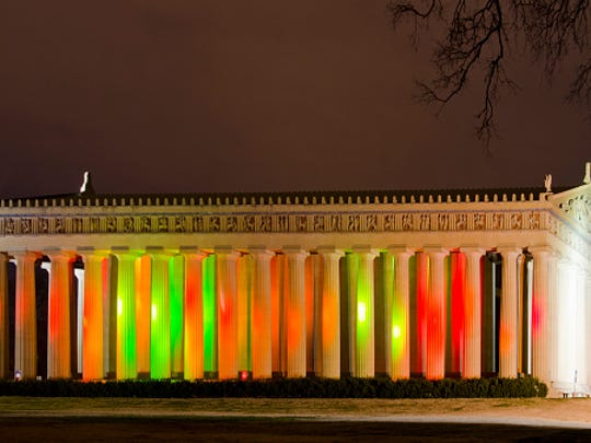 The Parthenon will be illuminated with holiday colors through Dec. 25.