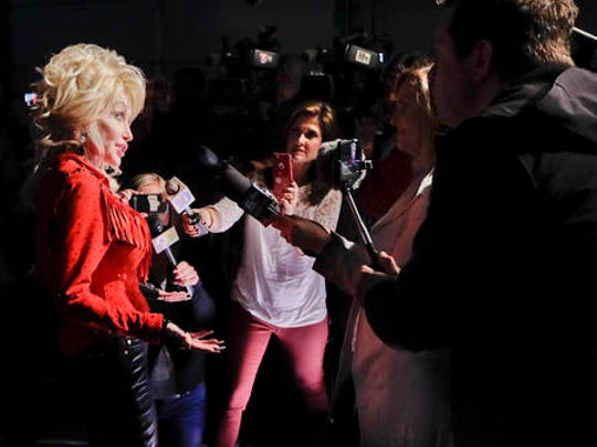 Dolly Parton is interviewed for her Smoky Mountain Rise Telethon Tuesday, Dec. 13, 2016, in Nashville, Tenn. Parton has lined up an all-star list of performers for a three-hour telethon to raise money for thousands of people whose homes were damaged or destroyed in Tennessee wildfires.