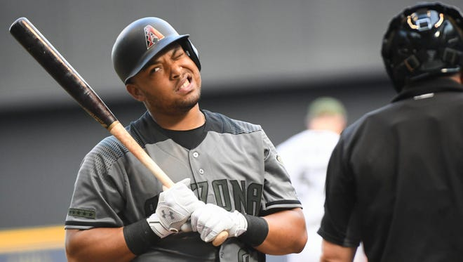 Arizona Diamondbacks left fielder Yasmany Tomas (24) reacts after being called out on strikes in the seventh inning during the game against the Milwaukee Brewers at Miller Park.