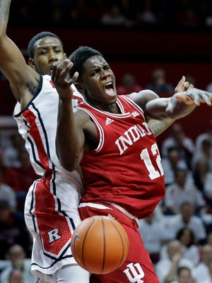 Indiana forward Hanner Mosquera-Perea (12), of Colombia, loses the ball as Rutgers forward Greg Lewis, left, defends during the first half of an NCAA college basketball game Sunday, Feb. 22, 2015, in Piscataway, N.J. (AP Photo/Mel Evans)