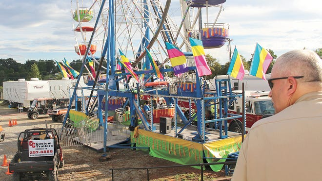 Law enforcement officers, including Officer Kenneth Bitner of Baileyton, Tenn., police, cordon off the area surrounding a Ferris wheel Aug. 8, 2016, after three girls were fell from the ride at the Greene County Fair in Greeneville, Tenn.