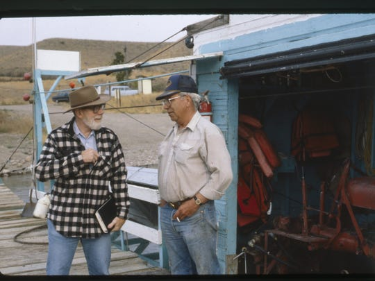 Ivan Doig and Ron Haaland standing on a dock together at the Carter ferry.