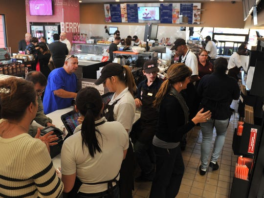 Dunkin' Donuts/Baskin Robbins employees rush to fill orders Thursday morning after the store celebrated its grand opening. According to previous Times Record News article, Dunkin' Donuts revealed in March 2016 that a new franchise group led by the Kurani brothers.
