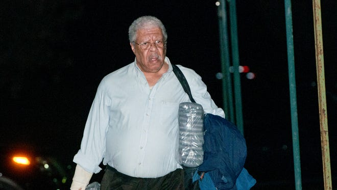 Former Ingham County Prosecutor Stuart Dunnings lll leaves the Clinton County Jail just after midnight Sunday, Sept. 24, 2017.