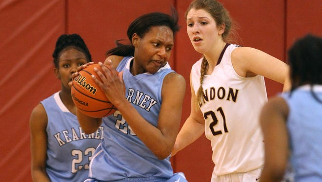 Kearney's Princella McCullough (22) pulls in a rebound in front of Mendon's Megan Plain.