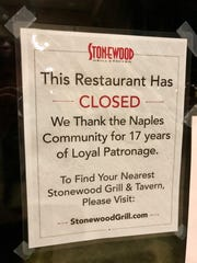 A notice on the door of Stonewood Grill & Tavern, which