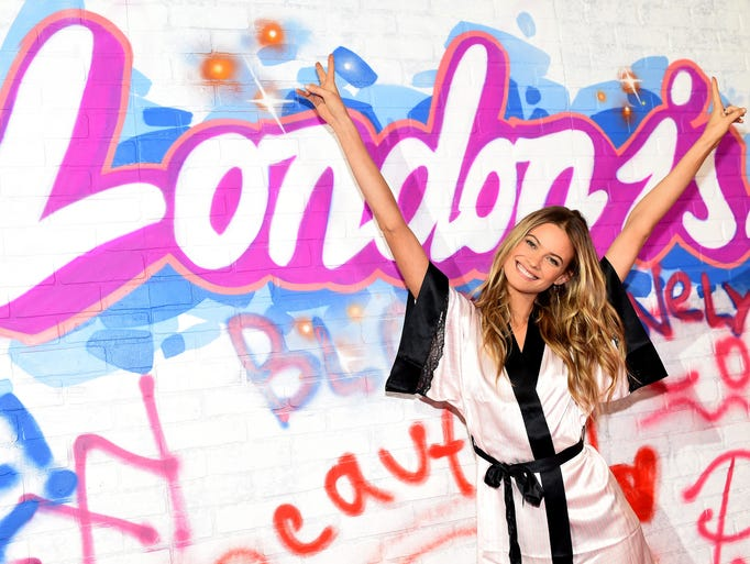 Behati Prinsloo is all smiles backstage prior the 2014