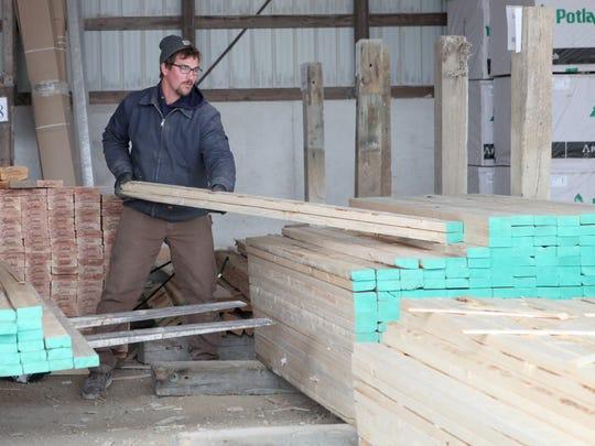 Matt Russel stocks 2x4x8 studs at Drexel Building