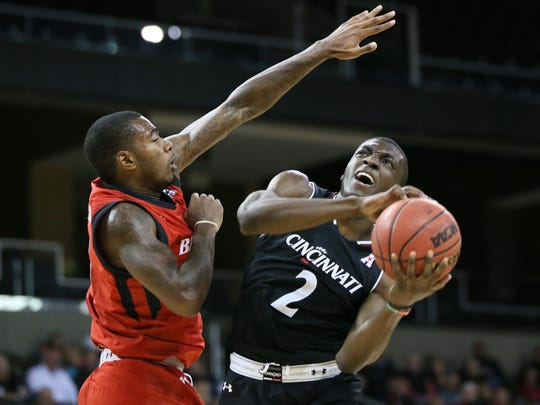 Cincinnati Bearcats guard Keith Williams (2) drives to the basket as Cincinnati Bearcats forward Gary Clark (11) defends in the second half during the Cincinnati Bearcats red versus black men's basketball scrimmage, Saturday, Oct. 28, 2017, at BB&T Arena in Highland Heights, Ky.