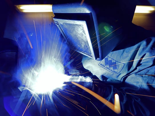 Brandon Hyde, 25, works on a project in a welding class