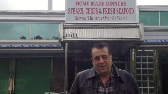 Nick Tsakonitis outside his Olympic Diner in Mahopac, Oct. 14, 2014. He said that he hoped to reopen within a month. A fire damaged the diner on Oct. 11, 2014.