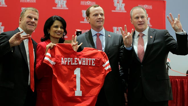 Houston athletic director Hunter Yurachek (right) is shown in a file photo after the Cougars' hiring of football coach Major Applewhite. Yurachek was officially hired as athletic director at the University of Arkansas on Monday.