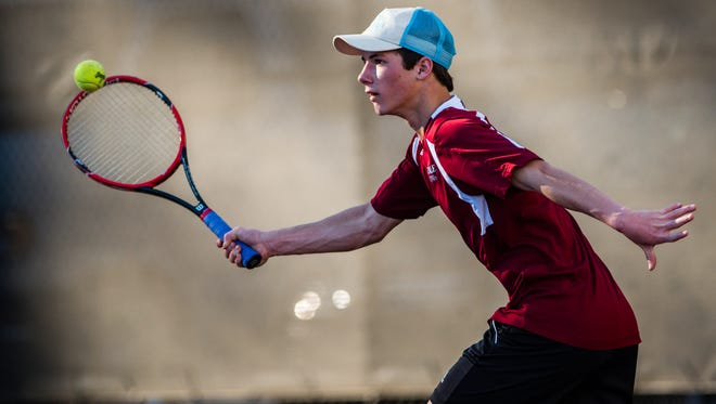 Asheville High sophomore Zach Theodossiou is the No. 1 singles player for the Cougars.