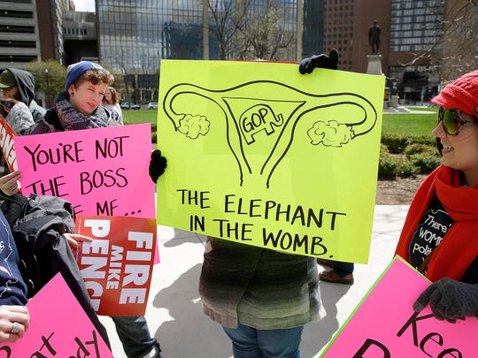 Thousands rally for women's rights on the south lawn of the Indiana Statehouse on April 9, 2016, in response to a controversial new abortion bill.
