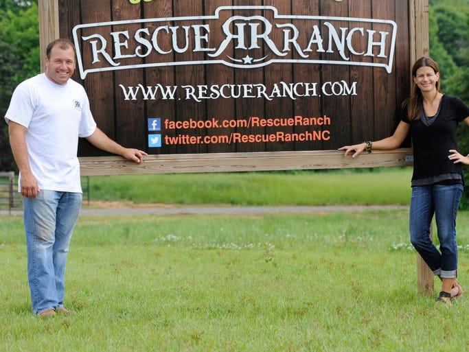 Ryan Newman, left, and his wife, Krissie, opened Rescue Ranch in October 2013. There are dozens of animals – goats, rabbits, birds, exotic reptiles and a cow among them – on the 177-acre property, all unwanted by their previous owners.