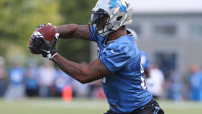 Lions tight end Eric Ebron catches a pass during training camp Monday in Allen Park.
