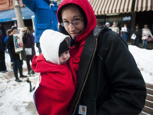 Grace Johnson holds 3-month old Ziva Grossmann during