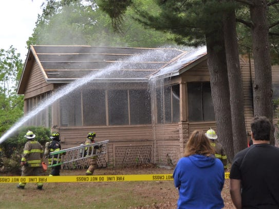 Susie and Jeff Berth watch as firefighters spray water
