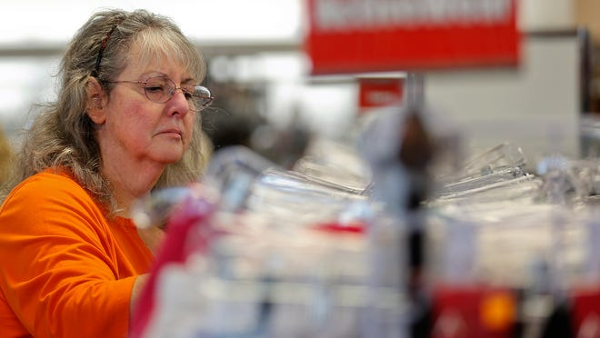 """Candi Fairhurst shops at the new Goodwill store on 7th Ave. S. Thursday. Fairhurst says, """"??there are a lot of good deals.""""?"""