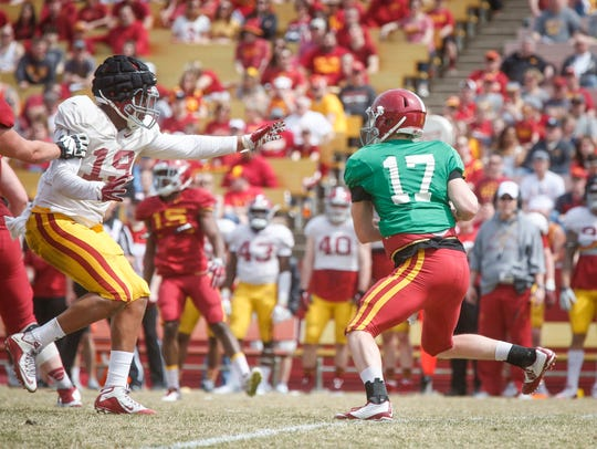 Iowa State sophomore defensive end JaQuan Bailey, left,