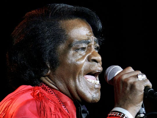 James Brown performs during a concert in Shanghai,